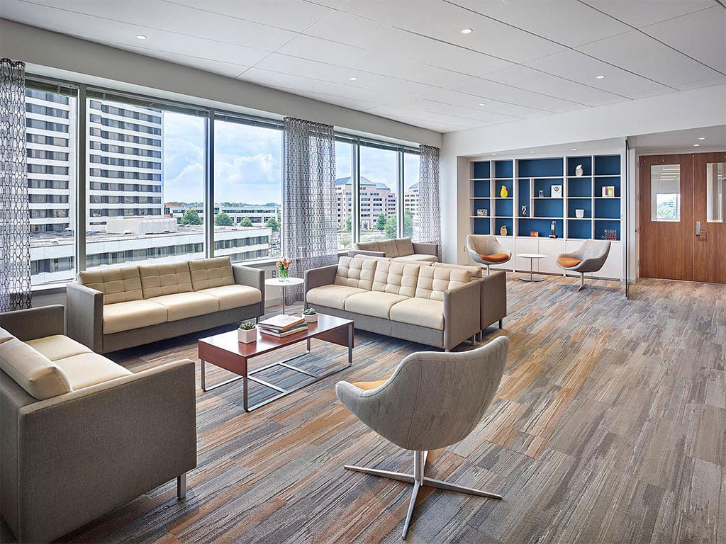 Is it an apartment or is it an office? This is the new modern workspace and Hygge is a huge part of this concept of home and coziness that's shifting into the corporate setting.